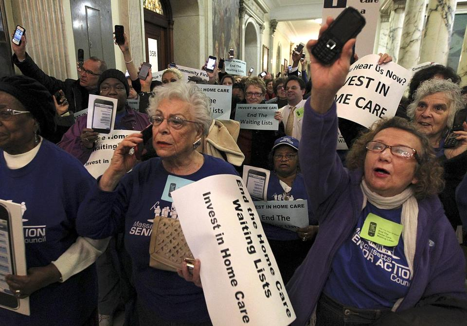 Kiki Chaiton, Jacinta Arena, and others seniors protested against waiting lists for home care at the State House yesterday. Michael Festa, the state's new AARP head, said funding the program will be one of his top priorities.