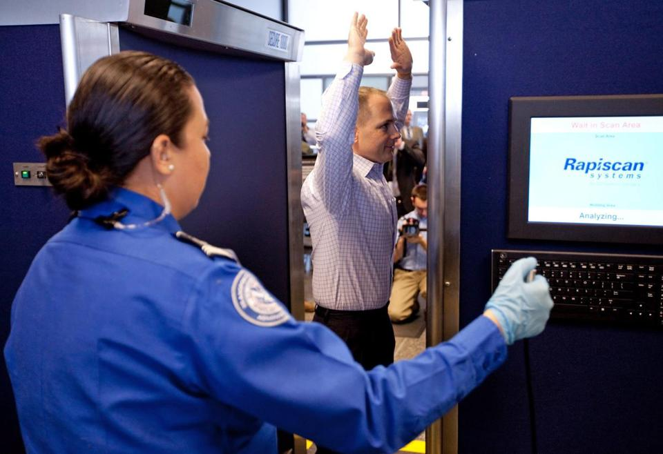 A TSA worker at Logan Airport demonstrated the Rapiscan scanner, which produces naked images of travelers.
