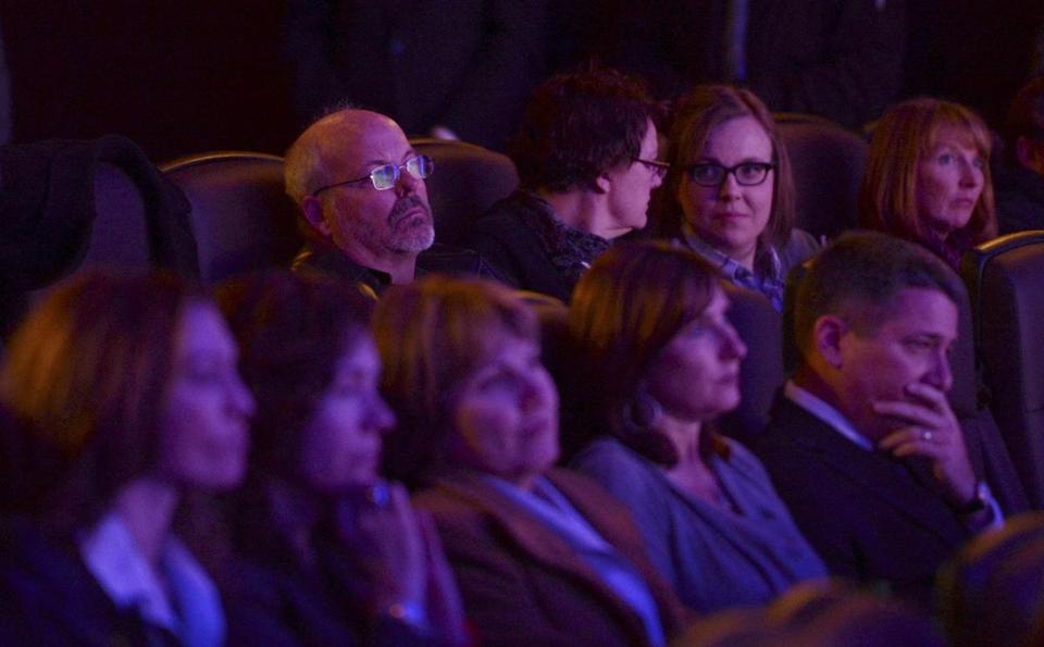 "Tom Sullivan (rear left), was among those at Thursday's reopening of the Aurora, Colo., movie theater where 12 people were killed in a shooting rampage July 20, including Sullivan's son, Alex. ""Nobody is going to stop us from living our lives the way that we lived our lives before,"" Tom Sullivan said."