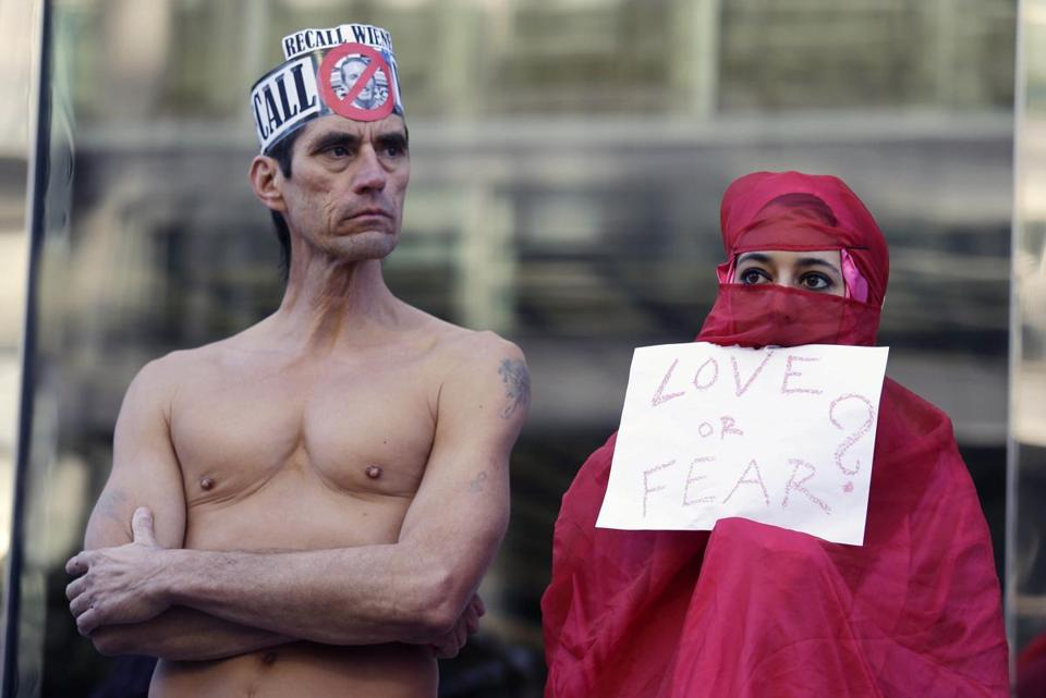 Natalie Mandeau (right) of France joined a protest Thursday against a San Francisco law banning nudity.
