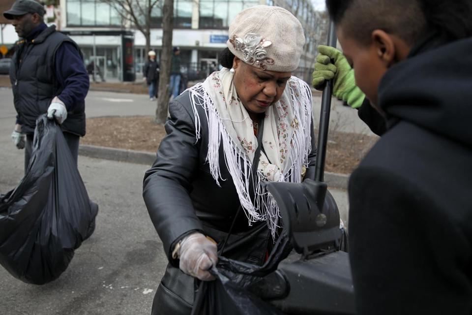 Gerthy Lahens (left) and Asia Carter picked up trash on Washington Street near Dudley Square in Roxbury on Saturday as part of President Obama's National Day of Service.