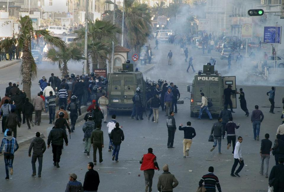 Near an Alexandria, Egypt, courthouse, demonstrators threw rocks as police used tear gas to quell the protests.
