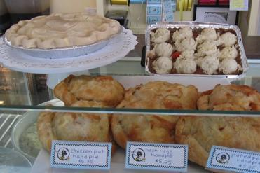 At Busy Bee Bakery in Melrose, baked hand pies are displayed in the case. On top are chicken pot pie (left) and shepherd's pie, topped with scoops of mashed potatoes, that are baked at home.