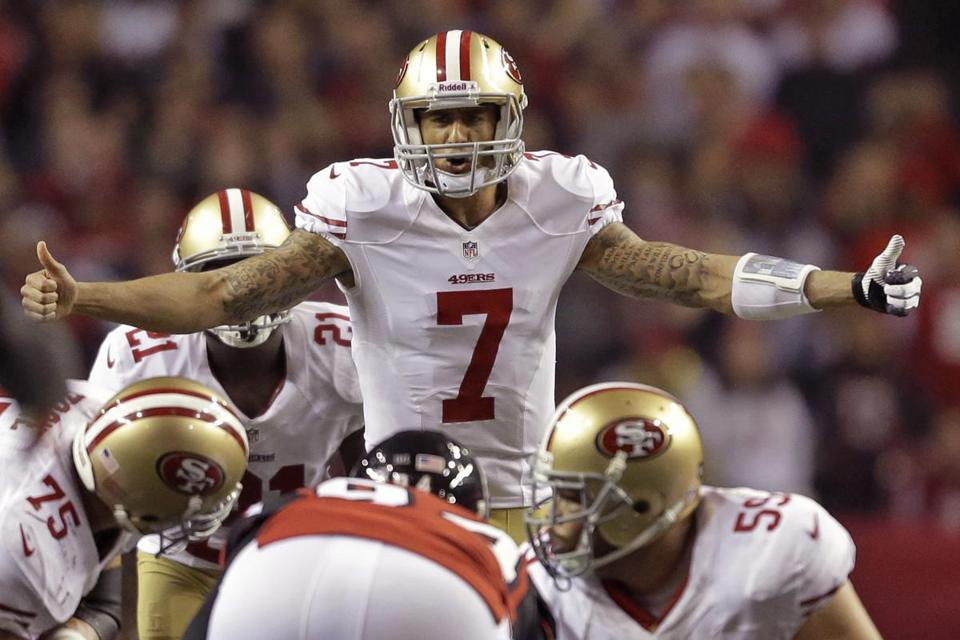 San Francisco 49ers quarterback Colin Kaepernick signaed to the line during the second half.