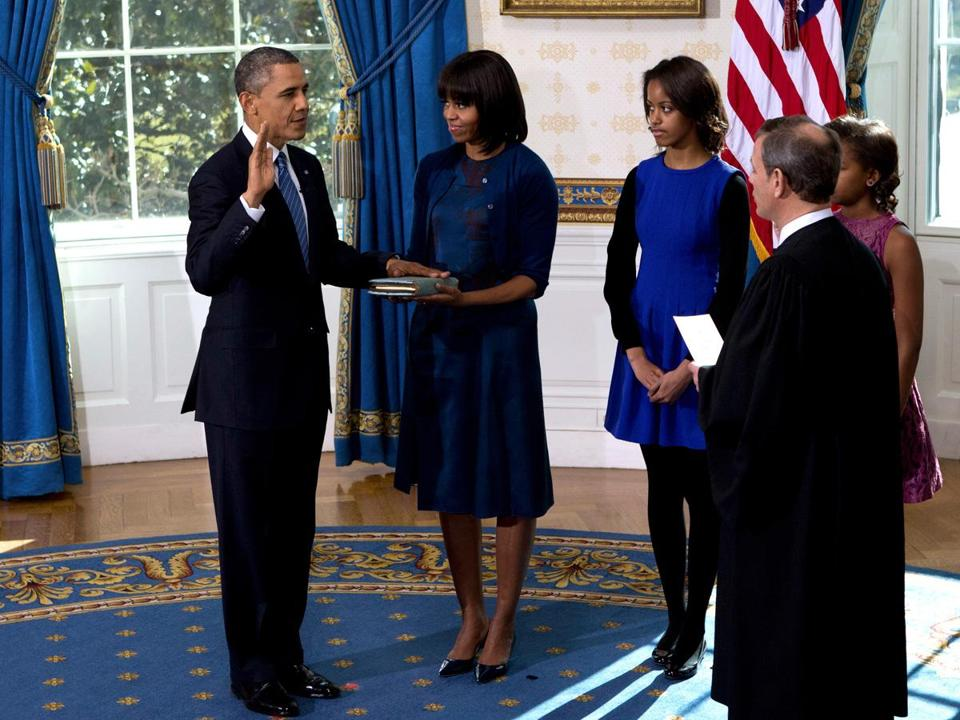 President Obama was officially sworn in by Chief Justice John Roberts. Michelle Obama held her family Bible.