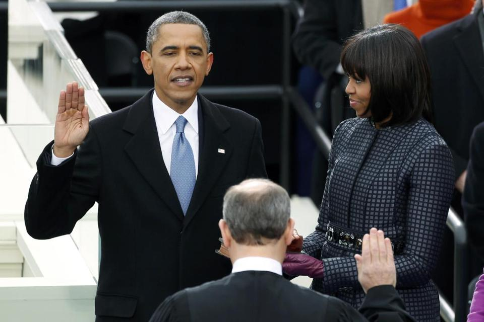 In a public reenactment, President Obama was sworn in by Supreme Court Justice John Roberts.