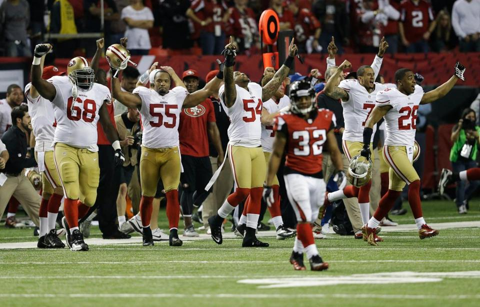 The 49ers begin the celebration after beating the Falcons to advance to the Super Bowl for the first time since 1995.