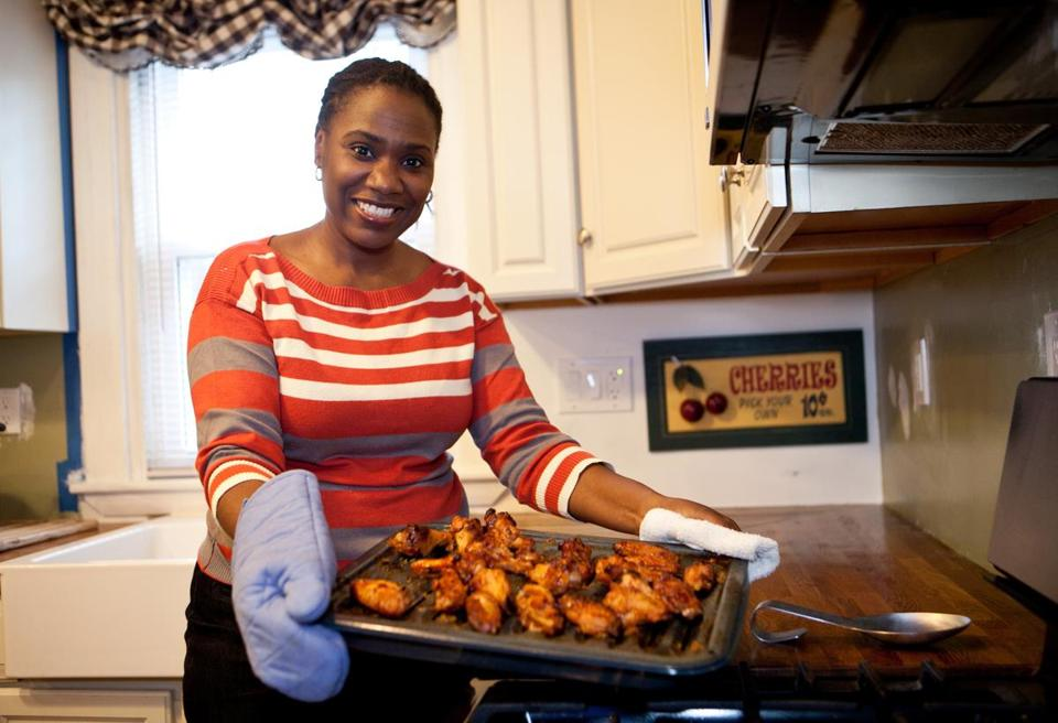 Michelle Gordon with the chicken dish she often serves for dinner in her Dorchester home.