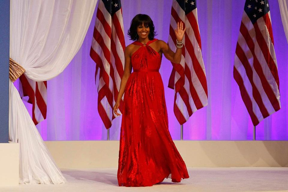 With its Grecian pleating, low back, and cinched waist, Michelle Obama's stunning scarlet dress  would be equally at home on the red carpet.