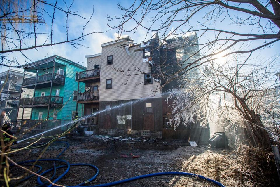 Firefighters battled a blaze at 142 Congress Ave. in Chelsea Wednesday. Officials said they do not know the cause, but a resident of the building said a man told her he had tossed a cigarette butt onto his second-floor porch.