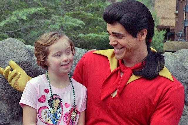 "Beverly Beckham's grand­-daughter Lucy, with Gaston from ""Beauty and the Beast,"" at Walt Disney World."