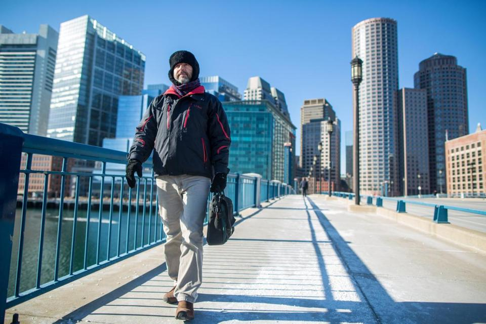 Jim Kelly, 52, of Bedford, walked in the cold along Seaport Boulevard on Thursday.