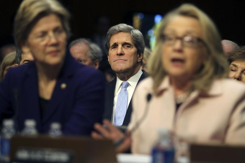 Senator John F. Kerry listened as he was introduced by Senator Elizabeth Warren (left), and Secretary of State Hillary Rodham Clinton before the Senate Foreign Relations Committee prior to the start of his confirmation hearing.