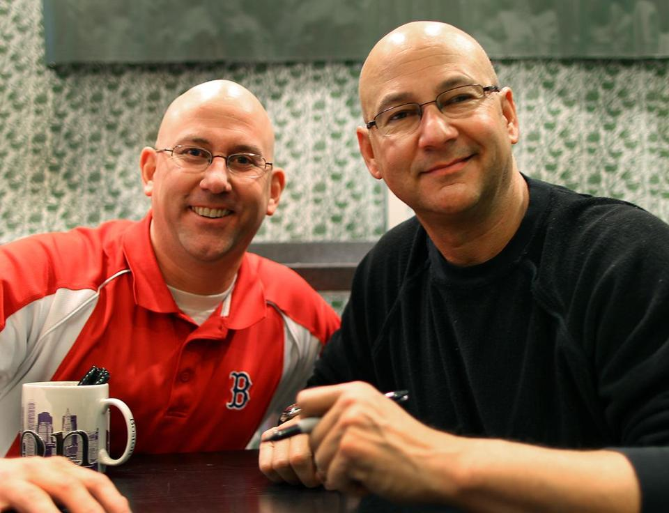 Terry Francona (right) with look-alike Sox fan Scott Johnson of Dudley at Friday's book signing.
