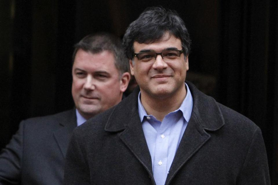 Former CIA officer John Kiriakou (right) leaving federal court with his lawyer, John Hundley, last year in Virginia.