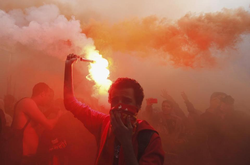 "Al Ahly fans, also known as ""Ultras"", celebrated and shout slogans in front of the Al Ahly club after hearing the final verdict of the 2012 Port Said massacre in Cairo."