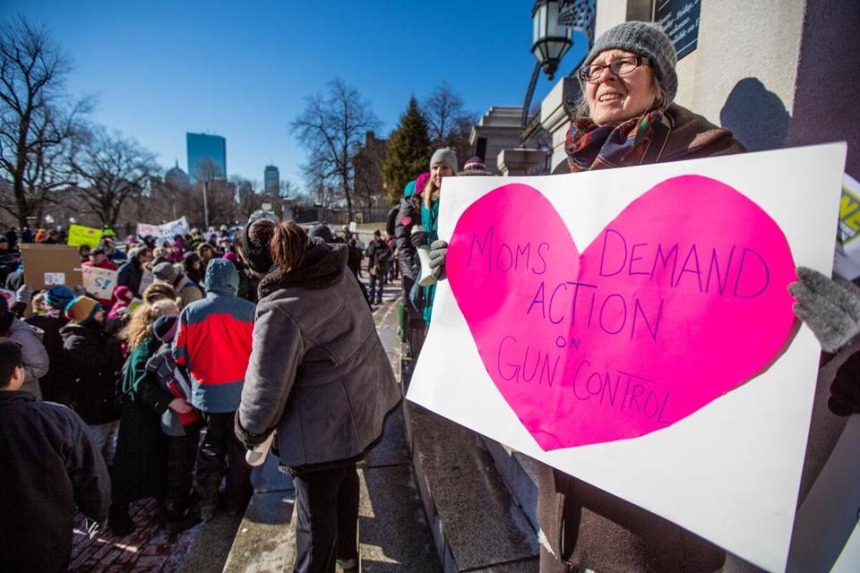 Lee Strasburger of Cambridge held one of the signs that have become the signature of One Million Moms for Gun Control.