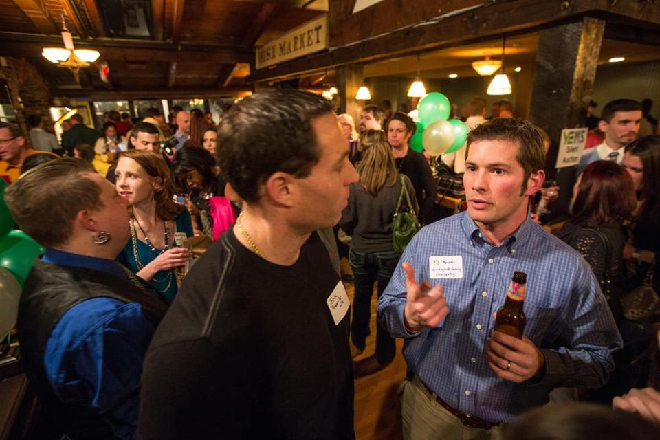 T.J.Macari (right), 32, of New England Osteopathy, mingles during a Young Entrepreneurs of the North Shore event in Salem.