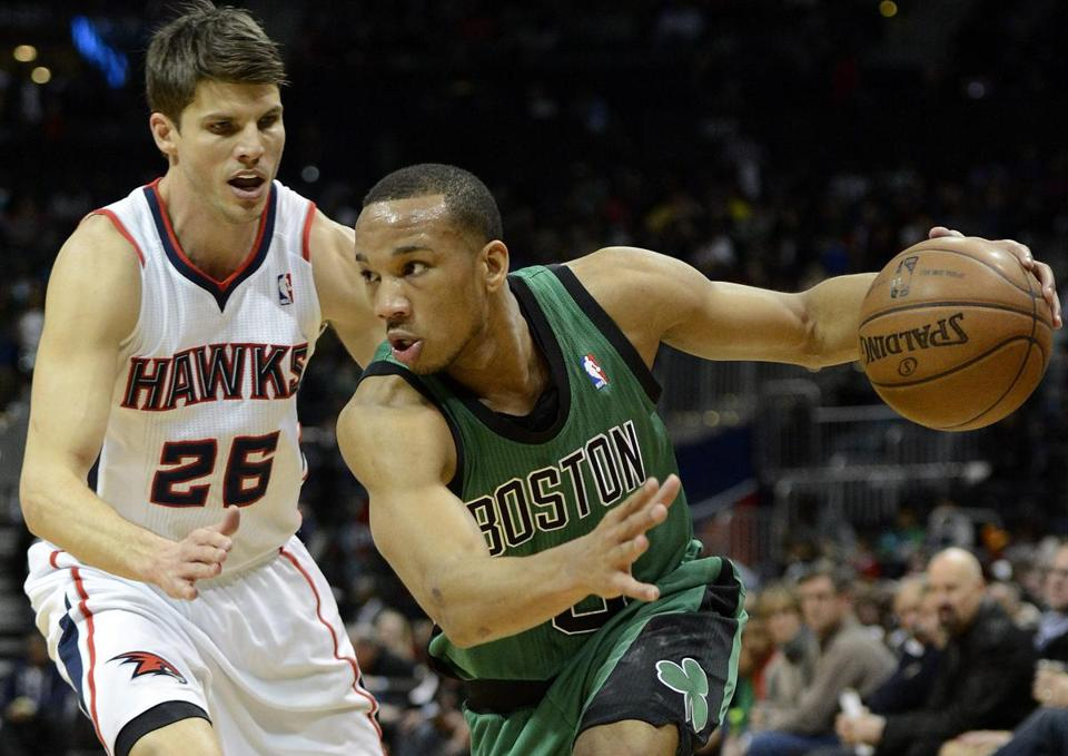 Avery Bradley drives on Atlanta's Kyle Korver, who was more effective on offense with 27 points (eight 3-pointers).