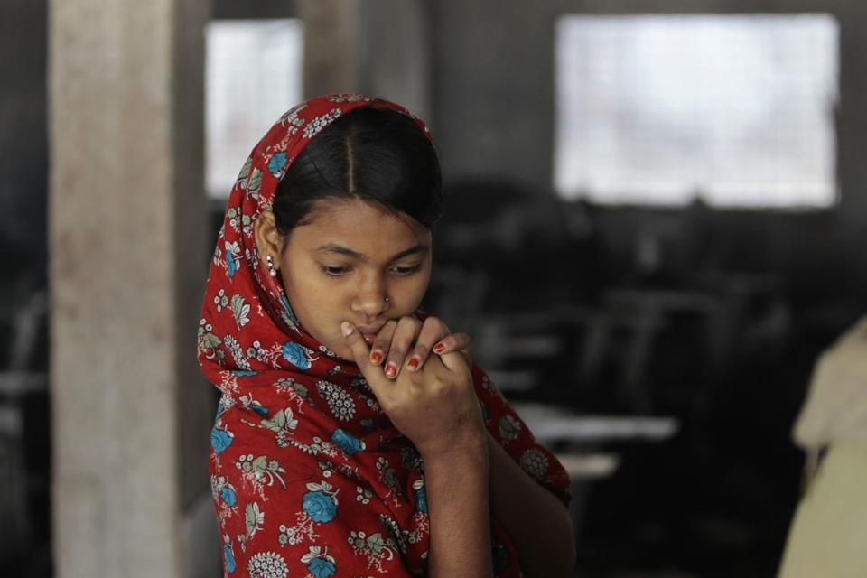 A worker looked at the remains of a garment factory where a fire took the lives of seven colleagues in Dhaka, Bangladesh. The father of one victim has filed a police case.