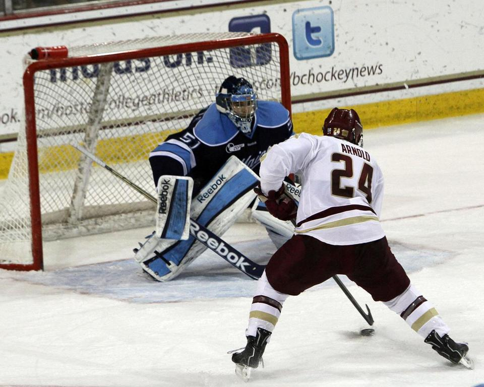 BC's Bill Arnold moves in on Maine's Martin Ouellette, who was solid with 24 saves.