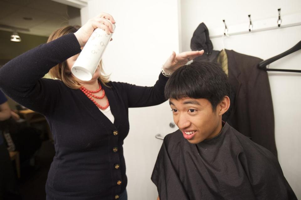 "Pittayut Phonboon of Sharon High endured a hair and makeup session before a recent taping of WGBH-TV's ""High School Quiz Show."" Rishi Solanki (right) and his Wellesley High teammates faced off against Chelmsford High."