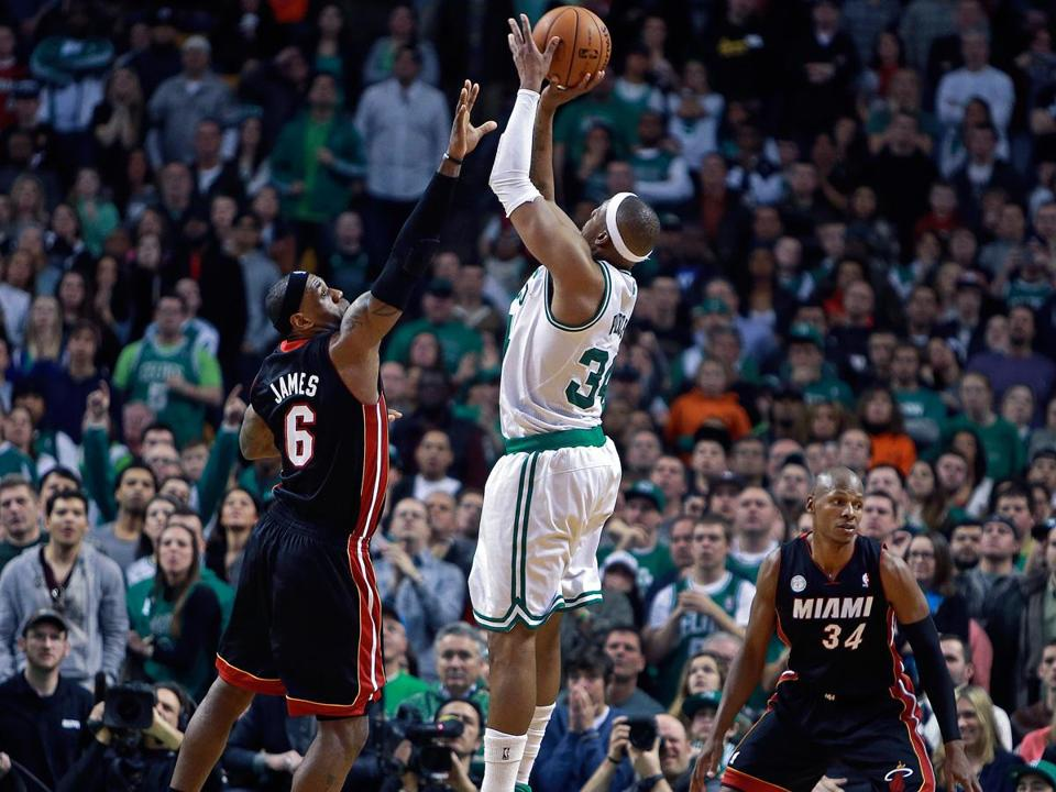 Ray Allen (right) is one of the only people not looking as Paul Pierce hits a shot over LeBron James in the second OT to give Boston a 99-98 lead.