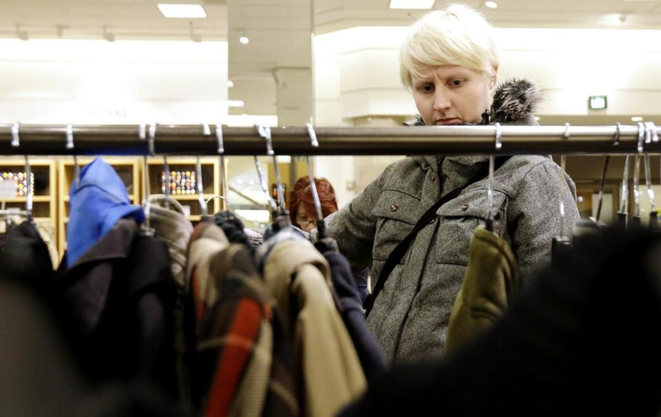 Despite the deal to stave off most tax increases, Social Security taxes rose in January, leaving consumers, such as this woman shopping in Chicago, with less take-home pay.