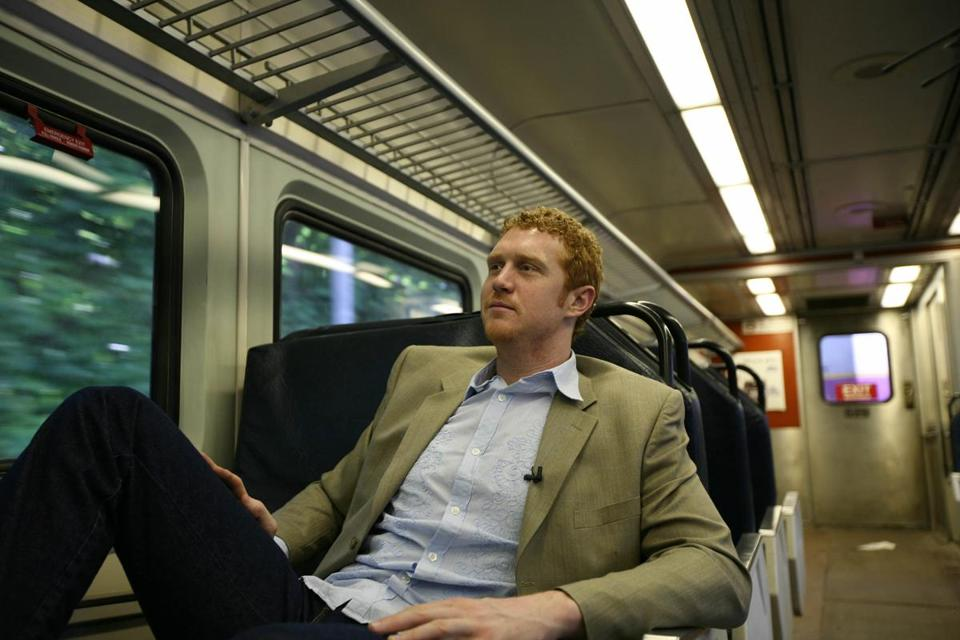 Forward Brian Scalabrine takes the MBTA commuter rail to North Station.