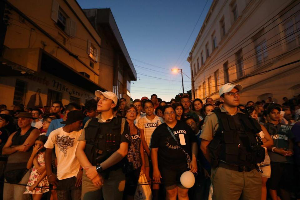 Mourners gathered outside the Kiss nightclub Monday in Santa Maria, Brazil. Funerals began for the more than 230 victims, most of them college students 18 to 21 years old.