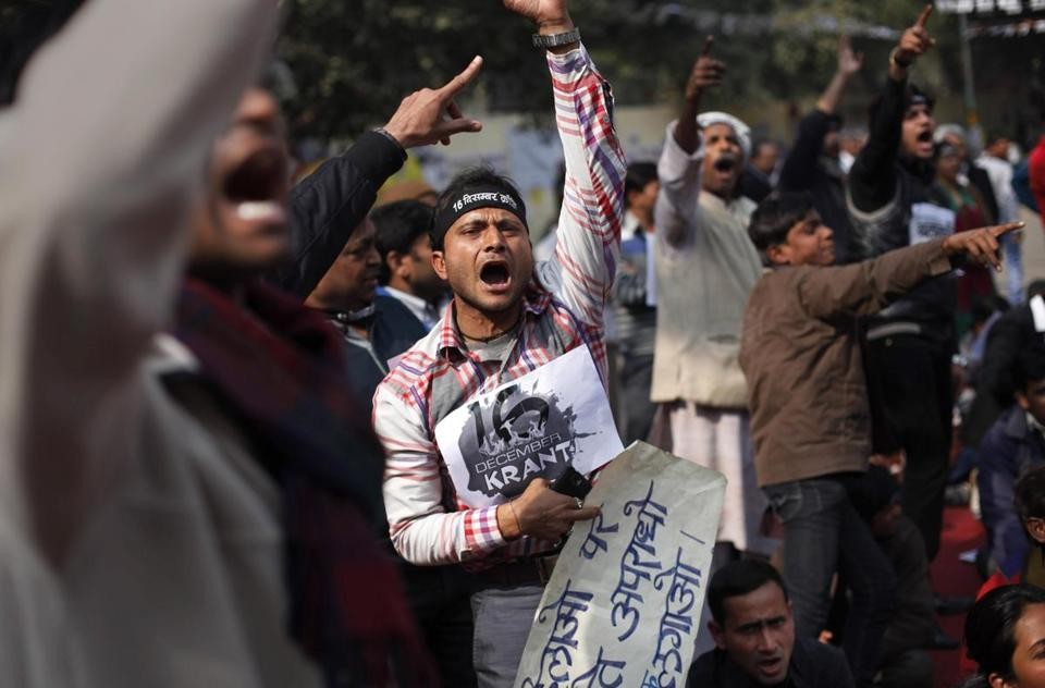 Protesters demonstrated outside India's Parliament on Tuesday, demanding the death penalty for six men accused of the fatal gang rape of a young woman in New Delhi.