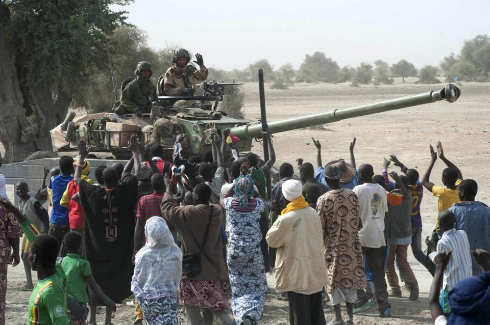 Residents greeted French troops as they entered Timbuktu with Malian soldiers.