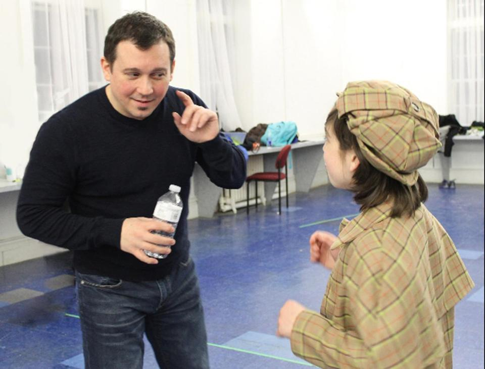 "Director Larry Sousa works with Alec Shiman at a rehearsal for ""Honk!"" at Boston Children's Theatre."