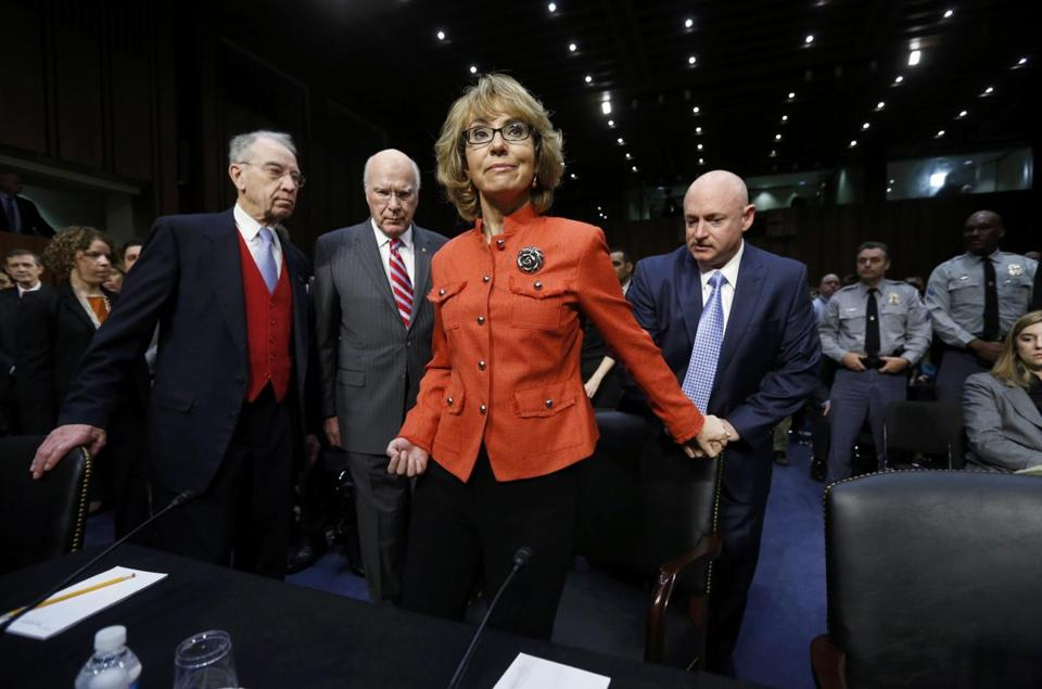 Assisted by her husband, Mark Kelly (right), former representative Gabrielle Giffords prepared to testify onWednesday.