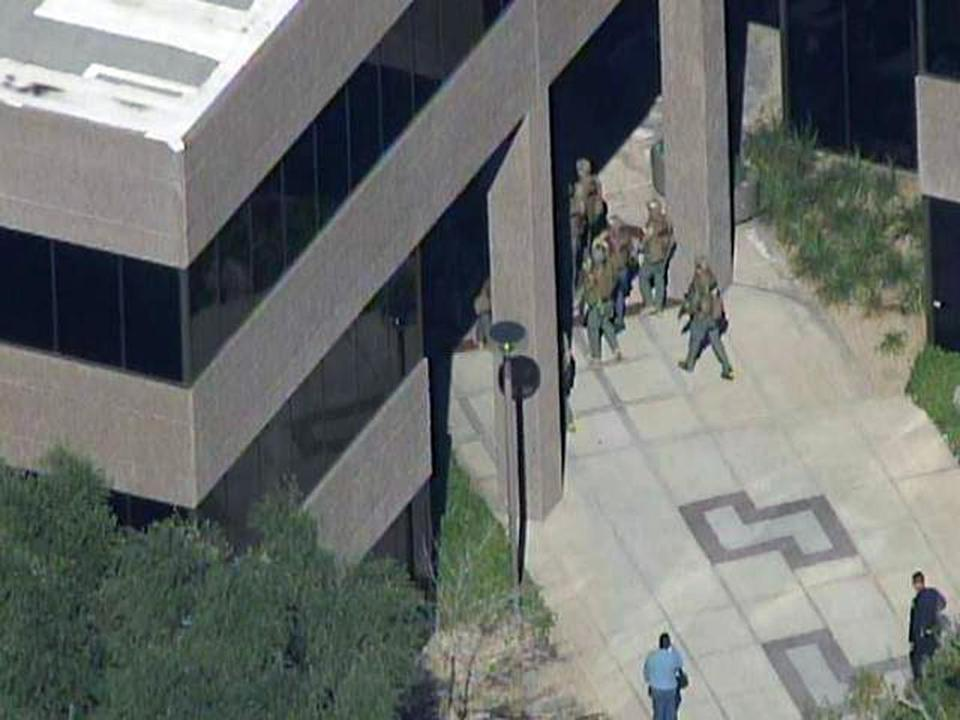 The scene at a Phoenix office complex where police say a gunman shot at least three people on Wednesday.