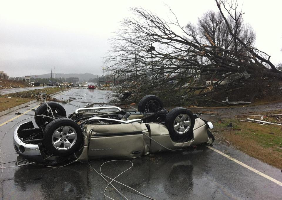 A car was flipped over as a tornado moved through Adairsville, Ga. on Wednesday.