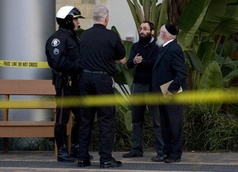 Police spoke with visitors to a medical office in Newport Beach, Calif., where a urologist was slain on Monday.