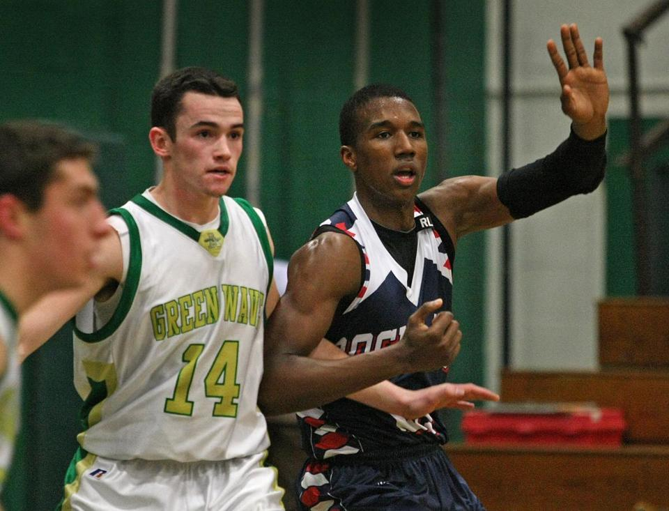 Rockland center Tyler Gibson reaches for the ball in his team's 67-53 win over Abington. The Gibson-led squad is 13-1.
