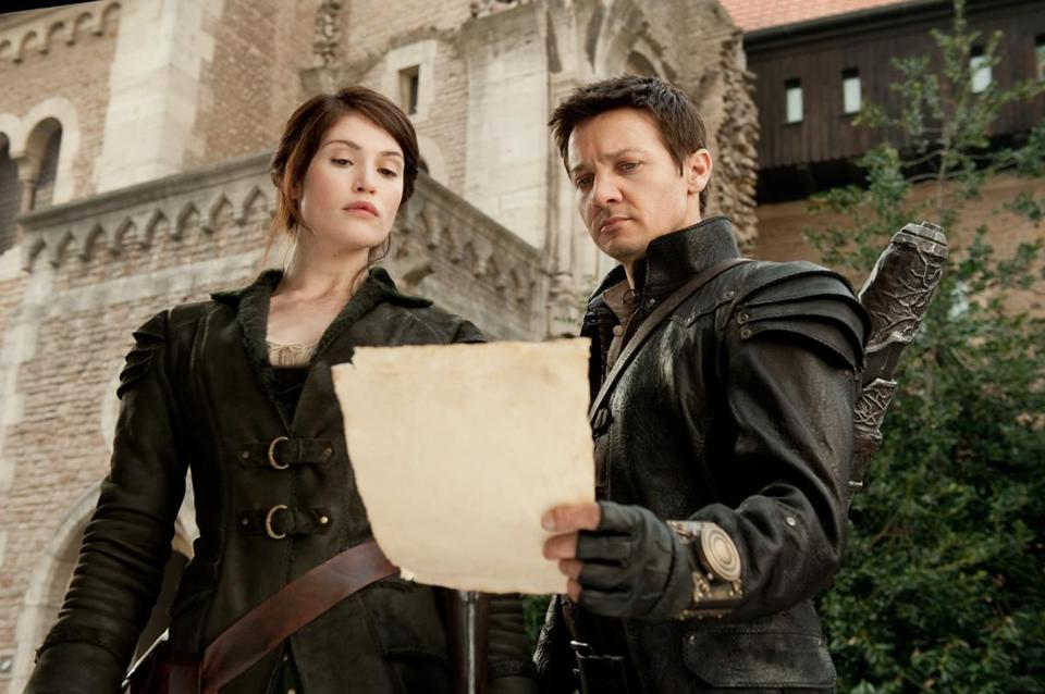"Gemma Arterton and Jeremy Renner in ""Hansel & Gretel: Witch Hunters."""