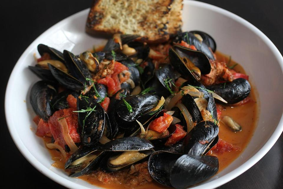 Mussels with house-made chorizo in a tomato-garlic sauce.