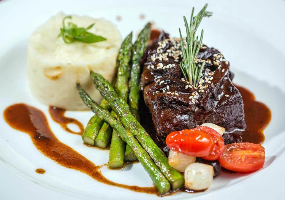 01/31/2013 CHARLESTOWN, MA Boneless short ribs with sesame, roasted prunes, asparagus, and mashed potatoes at Tangierino (cq) in Charlestown. (Aram Boghosian for The Boston Globe)