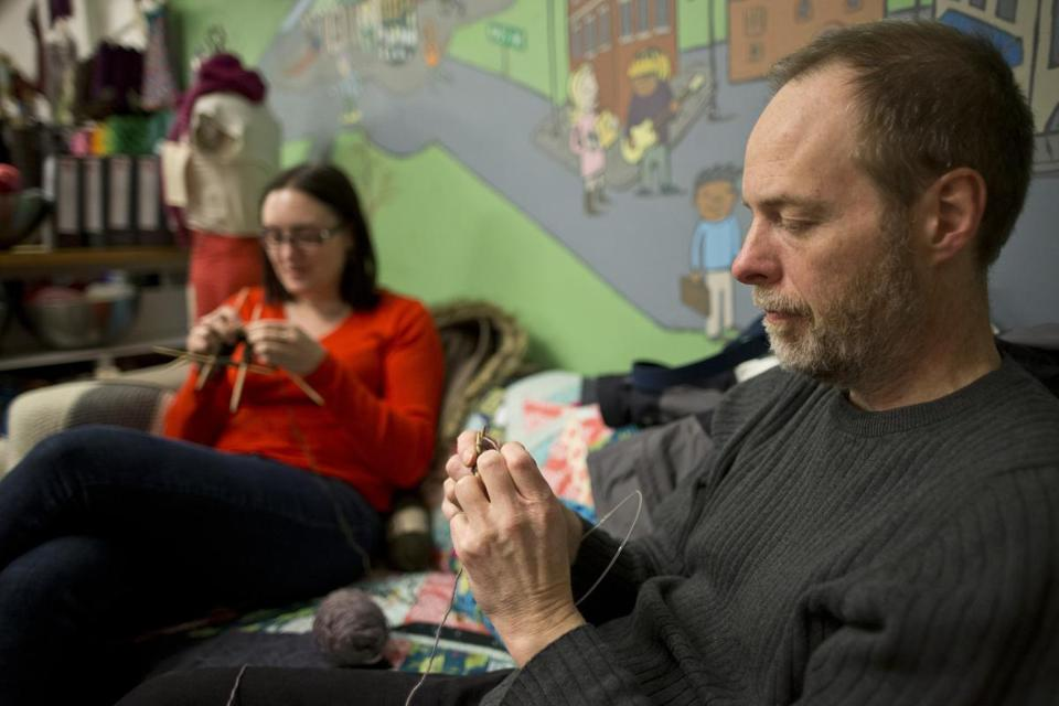 Tim Kardatzke and Kristina Muskiewicz concentrated on their needlework at a Cambridge coed knitting group.