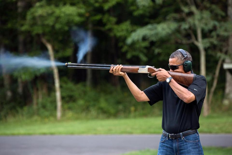 In this photo provided by The White House, President Barack Obama shoots clay targets with a shotgun on the range on August 4, 2012 at Camp David.