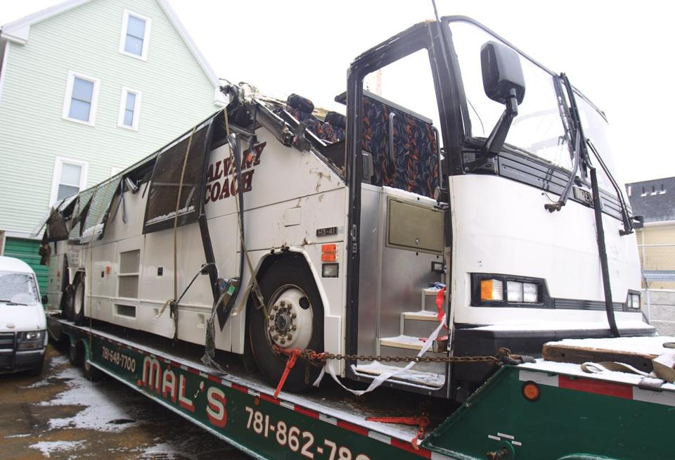 The Calvary Coach bus involved in Saturday's crash on Soldiers Field Road was carried on Sunday to a lot in in Arlington.