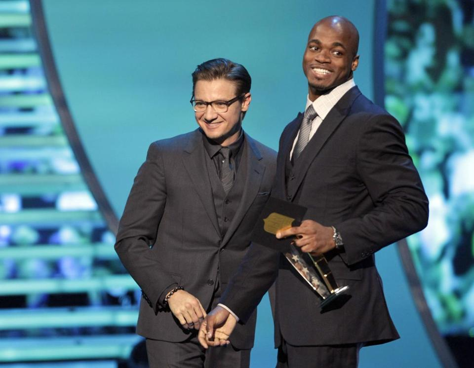 Actor Jeremy Renner presented the AP Most Valuable Player award to Adrian Peterson of the Minnesota Vikings.