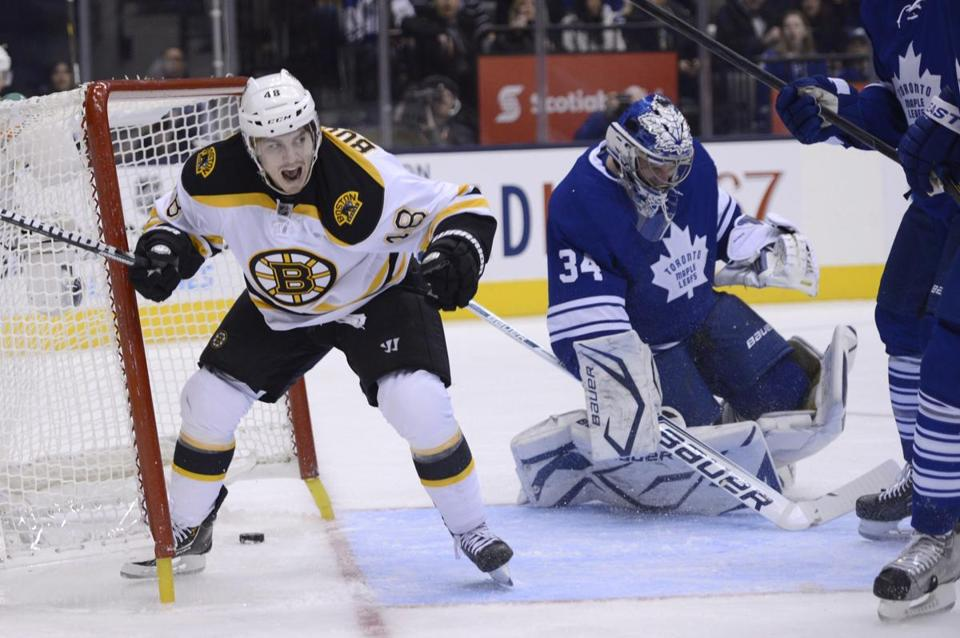 Boston Bruins left wing Chris Bourque celebrated his goal on Toronto Maple Leafs goalie James Reimer during the first period of an NHL hockey game in Toronto on Saturday, Feb. 2, 2013.