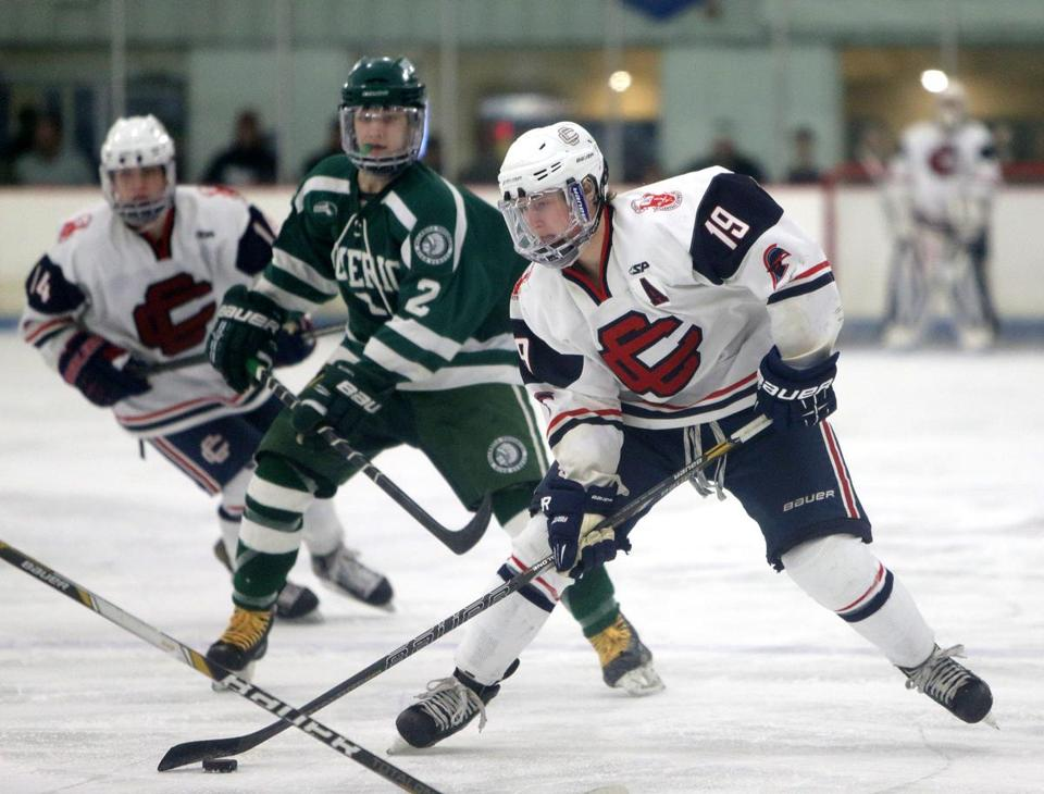 Central Catholic cocaptain Mike Kelleher (19) maneuvers the puck through the Billerica defense during his team's 6-0 victory. last Saturday afternoon.