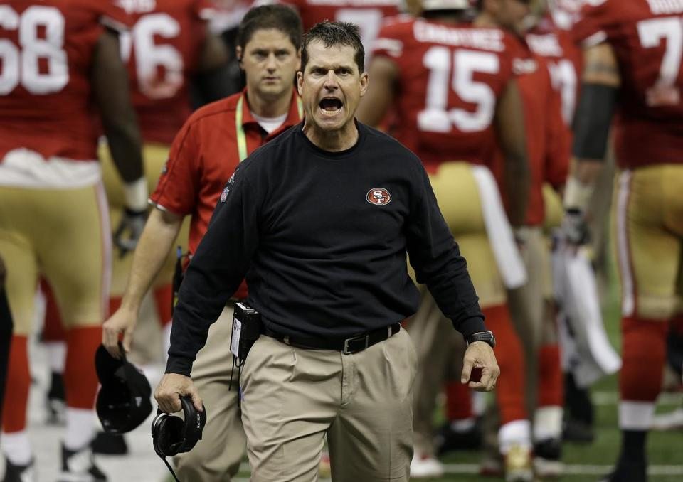 49ers head coach Jim Harbaugh protested a non-call by the officials after a fourth down play against the Ravens.