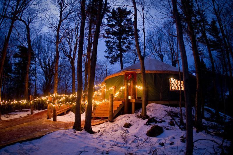Killington Resort in Vermont ferries dining guests to the intimate Ledgewood Yurt in a snowcat-drawn sleigh.