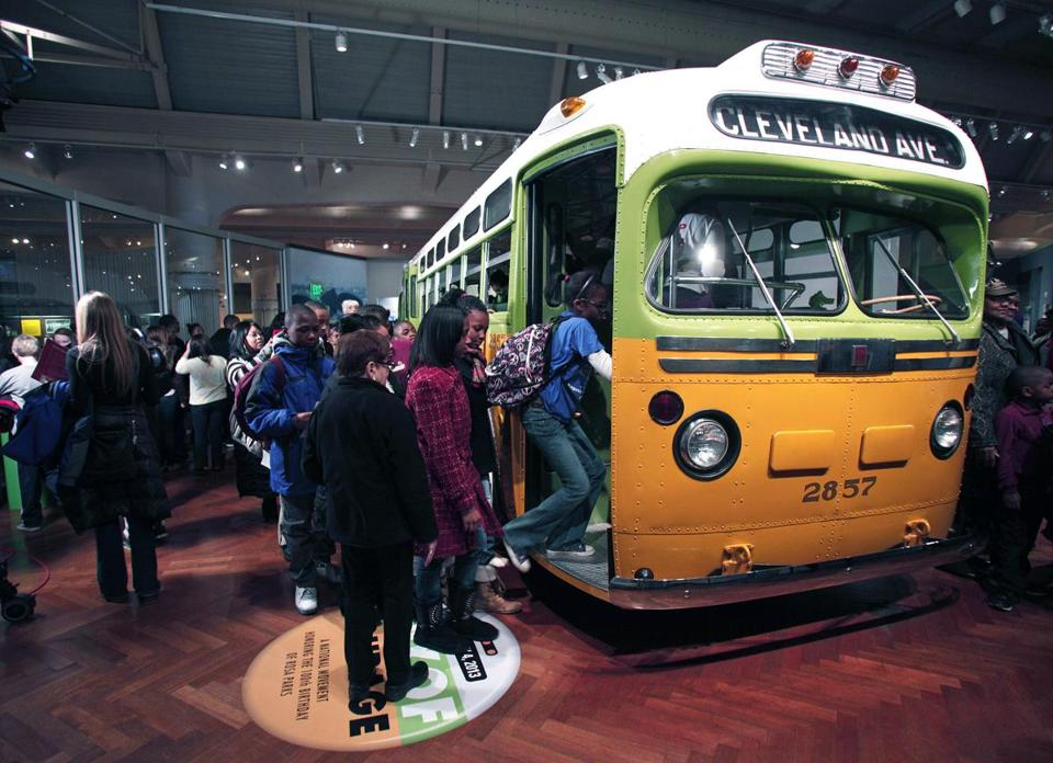 School children tour the bus that civil rights icon Rosa Parks made famous when she refused to give up her seat February 4, 2013 at The Henry Ford in Dearborn, Michigan.